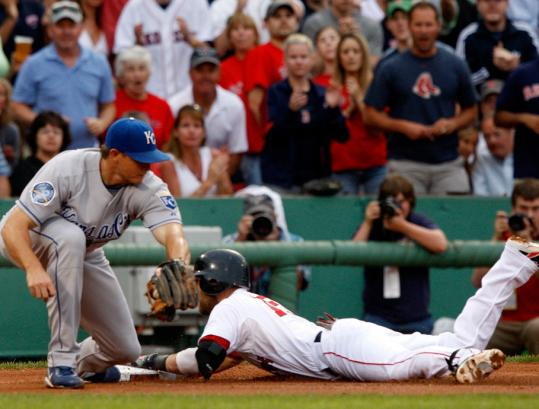 Dustin Pedroia got down to business early, beating the throw to Royals third baseman Mark Teahen for a first-inning triple. He scored the Sox' first run.