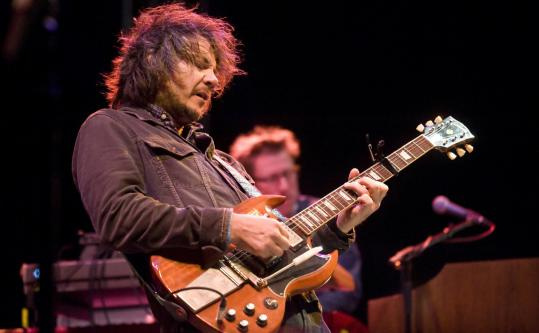 Despite heavy showers, Jeff Tweedy and Wilco entertained the crowd Saturday in Lowell.