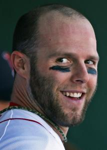 Dustin Pedroia smiles after scoring by deftly avoiding the catcher's tag.