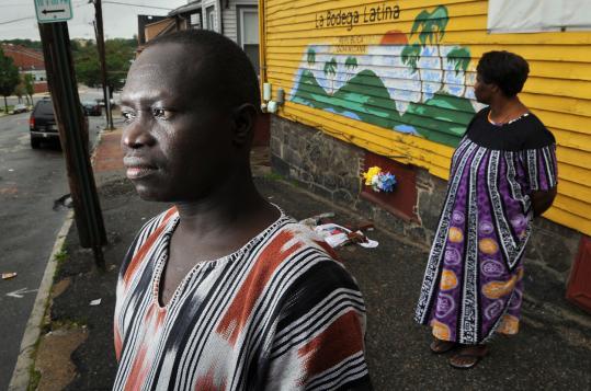 Edward Laboke with fellow Sudanese community organizer Sarah Espicho in Portland, Maine.