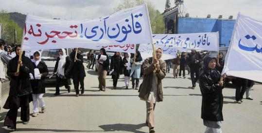 Afghan Shi'ite women marched in April to protest a law that, among other things, said they need their husbands' permission to leave the house and must be ready for sex every four days.