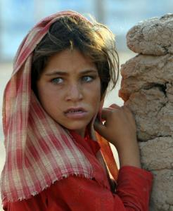 A Pakistani girl at the Jalozai refugee camp watches as families head for transport to return home yesterday.