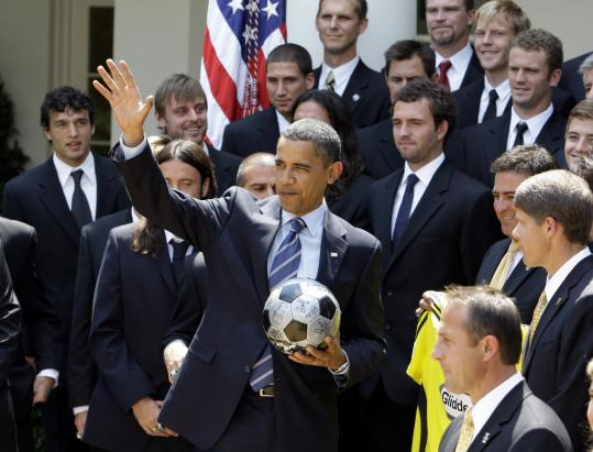 TEAM OBAMA - The president posed with members of the Columbus Crew soccer team yesterday during a ceremony in the Rose Garden at the White House.