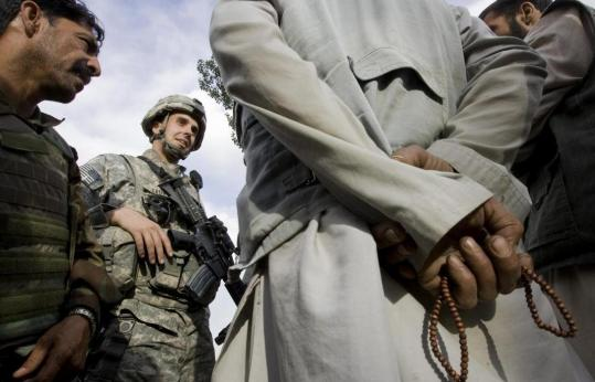 US Captain Matthew Crowe recently met with elders, one of whom clutched prayer beads, in Molahel village in the mountains of Wardak Province. The area is still under Taliban threat.