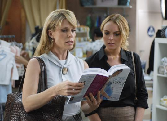 "Lindsay Lohan (right, with Cheryl Hines) fakes pregnancy to avoid getting fired in the ABC Family movie ""Labor Pains.''"
