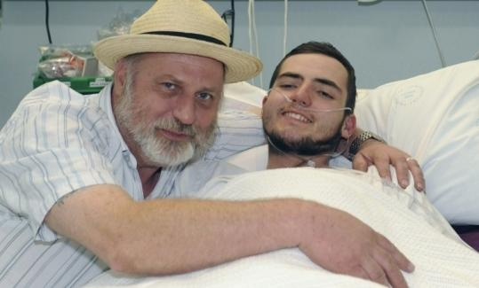 Richard Cass with his son, Jamie Neale, 19, who was lost in Australia's Blue Mountains for 12 days.