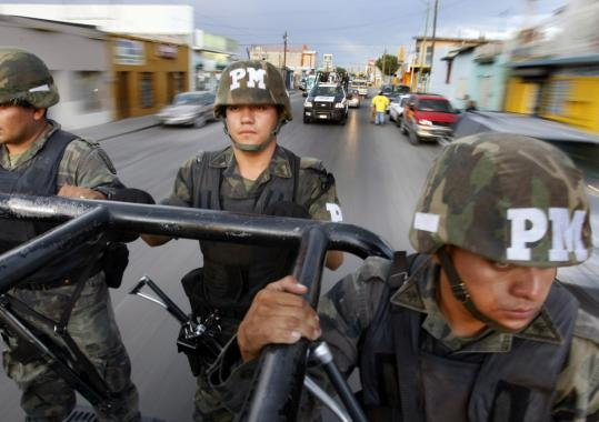 Mexican troops patrolled Ciudad Juarez, where 1,600 people were slain last year. The police chief quit in February after several officers were shot dead and he was threatened.