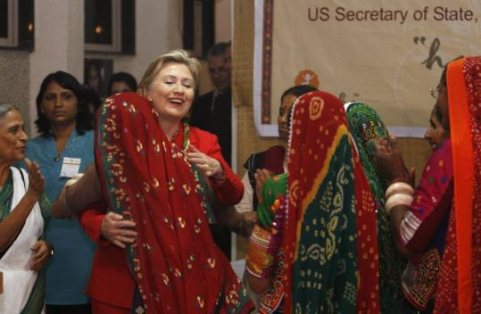Secretary of State Hillary Rodham Clinton embraced a member of the Self Employed Women's Association yesterday during a visit to the group's Mumbai, India, offices. She became aware of the association during a visit to India in 1995.