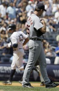 Tigers pitcher Justin Verlander watches Alex Rodriguez circle the bases on his go-ahead home run.