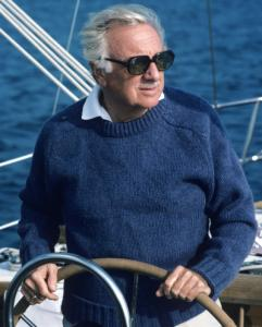 Walter Cronkite at the helm of his yacht, Wyntje, in 1983.