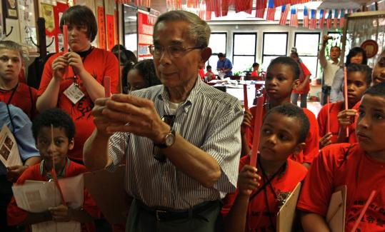 Frank F. Chin, 77, of Boston, demonstrated a prayer to students in a Chinese immersion program in Springfield.