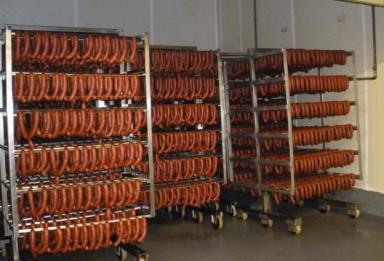 Sausages cool on racks after going through the smoking process at Gaspar's Sausage Company in North Dartmouth.
