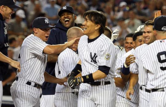 Designated hitter Hideki Matsui is mobbed by Yankees teammates after his game-winning home run against the Orioles. The Yankees have won four straight since the All-Star break.