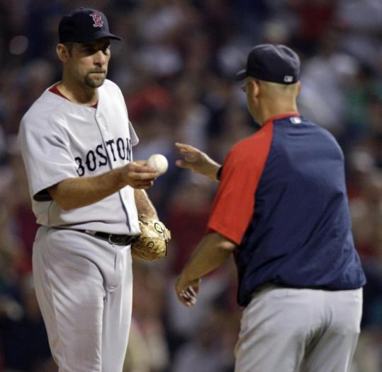 John Smoltz (1-3, 6.31 ERA) had to hand off to manager Terry Francona after allowing three home runs and four runs to the Rangers in the sixth inning.