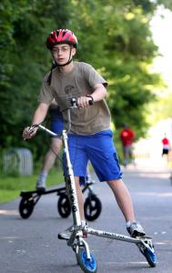 "Jonathan Watson, 13, of Merrimack, N.H., ""carves'' on a Trikke along the Nashua River Rail Trail."