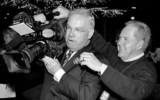 Videographer Warren Doolin, giving a few tips of the trade to Boston Mayor Thomas M. Menino.