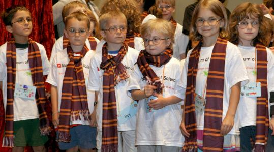 Decked in Harry Potter garb, children from summer classes at the Museum of Science participated in yesterday's preview of a Harry Potter exhibit at the museum.