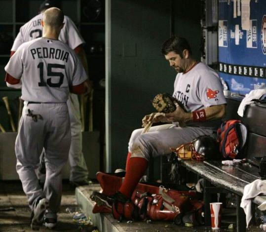 David Ortiz is followed out of the dugout by Dustin Pedroia and Jason Varitek sits after the Red Sox' fifth straight loss.