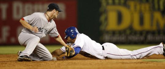 Nelson Cruz of the Rangers slides in safely to second base as the Red Sox' Nick Green tries to apply the tag in the fifth inning.