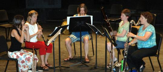 """The Vento Chiaro woodwind quintet (from left: Joanna Goldstein, Ana-Sofia """"Sofie'' Campesino, Anne Howarth, Ellen Barnum, and Michelle Doyle) was founded by Goldstein at the Peabody Conservatory in 1997."""