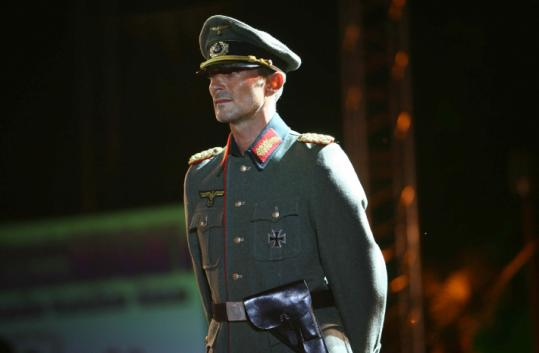 Constanta's mayor, Radu Mazare, dressed up as an officer in the Nazi military at a fashion parade at a Black Sea resort.