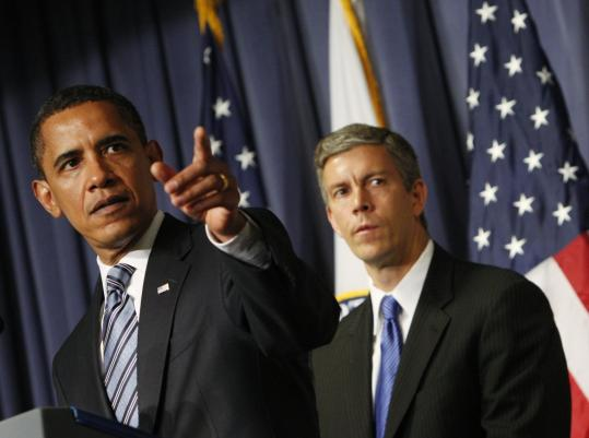 President Obama, with Secretary of Education Arne Duncan at the Department of Education headquarters in Washington yesterday, announced a national education competition with more than $4 billion in federal dollars as the prize.