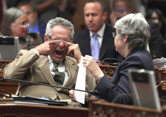 Senator Alan Lowenthal rubbed his eyes and yawned as he spoke with Senator Christine Kehoe in the early morning hours at the Capitol in Sacramento.