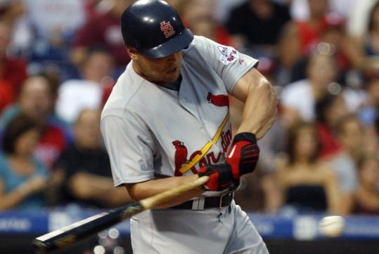 Matt Holliday got going right off the bat with the Cardinals, singling in his first at-bat just hours after he was traded from the Athletics.