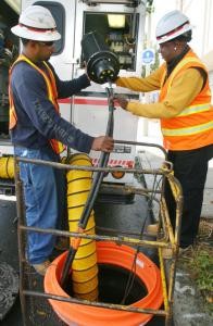 Verizon workers lay fiber-optic cable on Dorchester Avenue.