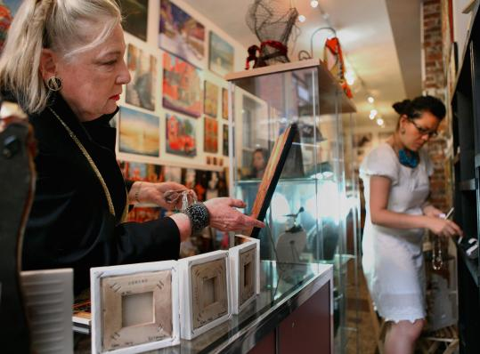 Art gallery owner Donna Agnew (left) says, &#8220;I would like to slow down a little more, but the way things are, I am speeding up.&#8217;&#8217;