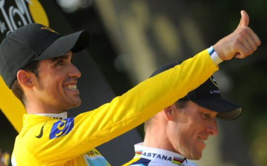 Alberto Contador (left) gives thumbs-up to his Tour de France victory, but of teammate Lance Armstrong, he says, &#8220;We are totally incompatible.&#8217;&#8217;