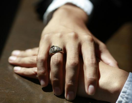 Alan, an illegal immigrant, displayed his Harvard class ring.