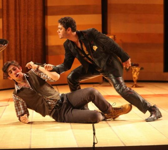 Elliot Madore (right, with Evan Hughes) plays Don Giovanni as a smooth criminal in jacket and leather pants.