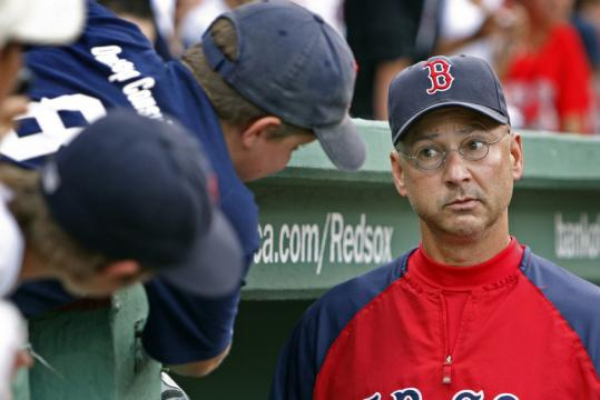 Manager Terry Francona talked baseball with a young fan at Fenway Park.