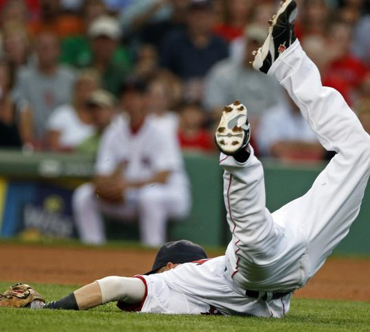 There's no twisting this fact: Dustin Pedroia goes all out. He ends up on the turf after barehanding a ball on the run and throwing to first in the first inning.