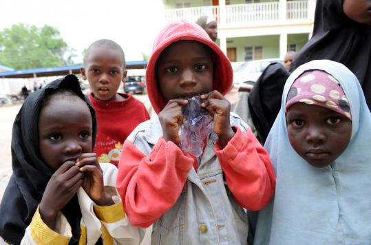 Children took refuge yesterday in a police office after clashes between security forces and Islamist radicals in Maiduguri. Fighting in the northern Nigerian city raged for a second day.