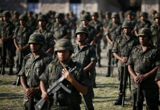 Soldiers stood at attention at the military base in Morelia, Michoacan, earlier this month. Authorities have arrested 76,765 suspected drug traffickers since December 2006.