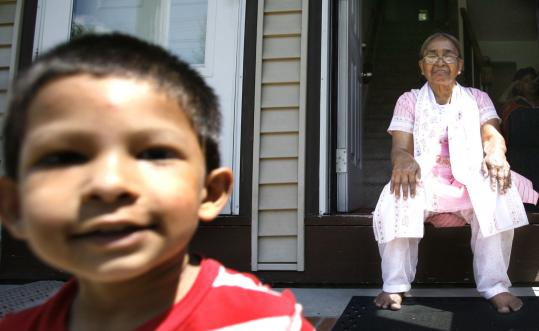 Rahima Begum, 63, of Woburn, an immigrant from Bangladesh, with her grandson Jeeshan Wahab. Begum - who suffers from high blood pressure, diabetes, and arthritis - was concerned about cuts to healthcare for legal immigrants.