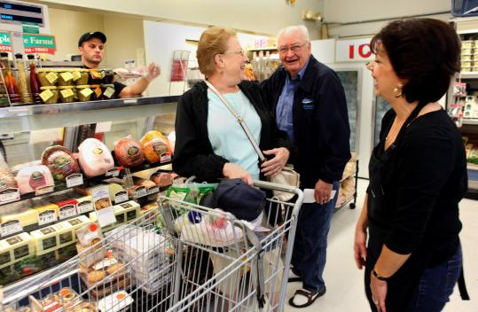 Tina McDonald (right) greeted regular customers at Chatham Village Market. Supporters relish its personal service.