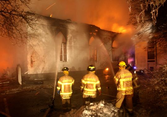 Firefighters battled a blaze that destroyed Temple Ahavat Achim on Middle Street in Gloucester on Dec. 15, 2007. An apartment building was also destroyed in the fire, which left one man dead.
