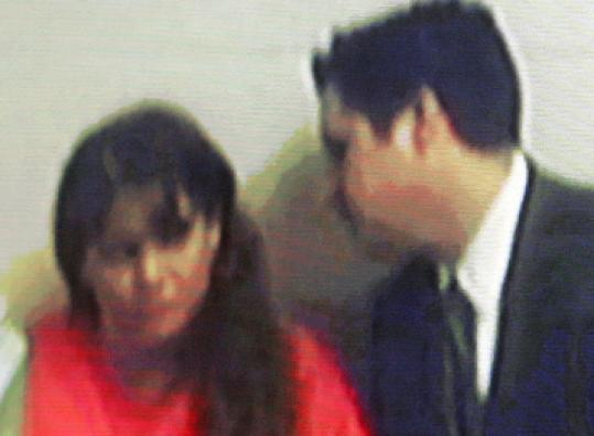 A video image was released of yesterday's arraignment of Julie A. Corey, 35, shown with her court-appointed lawyer.