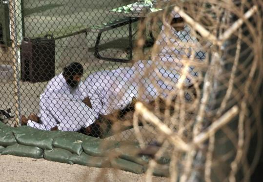 Detainees at the Guantanamo Bay prison prayed before dawn in May, in an image reviewed by US military authorities. Nineteen of the 28 men ordered freed remain held at the facility.