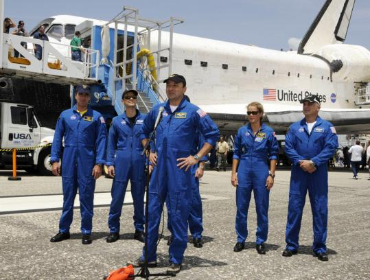 Commander Mark Polansky and his crew stood in front of Endeavour at a news conference in Cape Canaveral, Fla.. Their shuttle flight lasted 16 days and spanned 6 1/2 million miles.