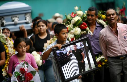 'I want to see him. I don't know him. Even if it's this way, I am going to meet him,'' said Brandon Zepeda, 9, at his father's funeral in Guatemala.