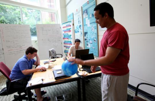 At Babson College in Wellesley, high school intern Adam Cohan (left) worked with Anton Yakushin (rear) and Raul Pellerano on their start-up, BongoBing.com, during the Summer Venture Program.
