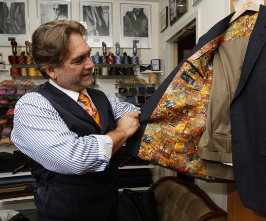 "Tailor-to-the-rich-and-famous Alan Rouleau sizes up his clients this way: ""I haven't seen guys dressing up like this in years. I think they want to show they're serious.''"