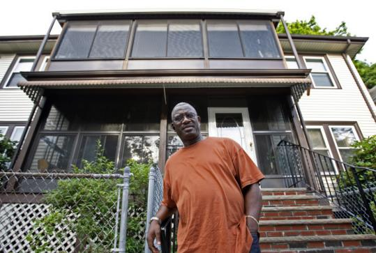 Vietnam veteran Jerome Hart is working two jobs and struggling to keep up with payments on his Dorchester home.