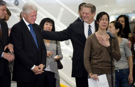 Journalist Laura Ling (right front), thanked former President Bill Clinton for his assistance in the release of herself and fellow journalist Euna Lee (right), along with former Vice President Al Gore and family members in Burbank, Calif., yesterday.
