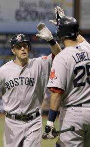 Jason Bay, getting congratulated by Mike Lowell, hadn't homered since July 7 before hitting one against the Rays.