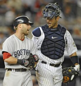 Dustin Pedroia wasn't telling what he talked to Yankees catcher Jorge Posada about, although getting hit in the shoulder by a pitch in a blowout could have been a hot topic.